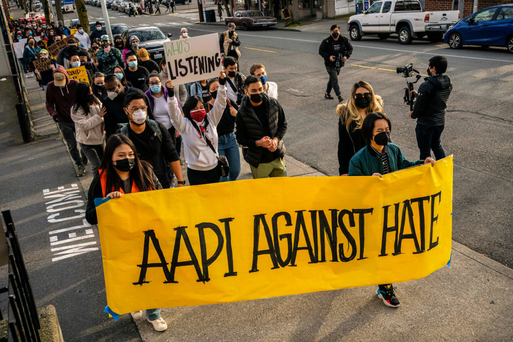 Marchers carry signs for AAPI against hate